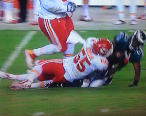 Notice how McCoy's ankle gets crushed under the Chiefs' defender.