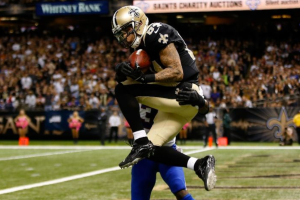 Kenny Stills leaps over a Buffalo defender to make one of his many spectacular catches