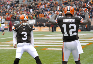 One of these guys is good at football and the other is named Brandon Weeden