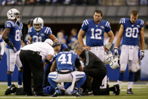 Andrew Luck is on the verge of tears as he watches Wayne go down and realizes the horrors that will come during the ARW era